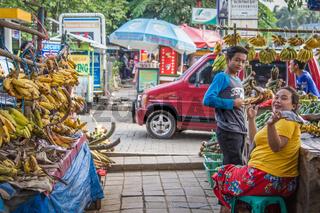 Woman selling bananas o in Bogor, West Java, Indonesia.