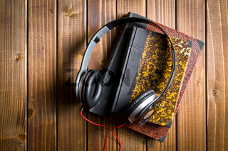 headphones with antique books