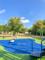 Large neighborhood playground with artificial grass in Flower Mound, Texas, America