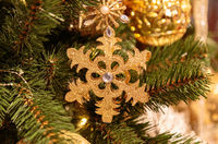 Christmas background with decorative Gold glitter snowflake, fir branches and pine cones