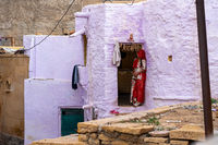 Woman in front of house in Jaisalemer, India