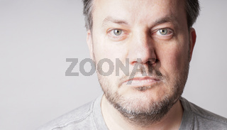 mid adult man looking at camera - close crop headshot with copy space