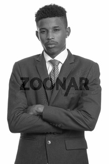 Young handsome African businessman in black and white