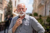 Old rich man with beard on street portrait
