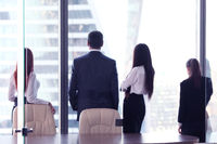 Business people looking at window