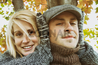 Young couple having some autumn fun
