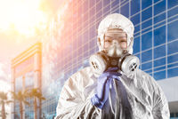 Chinese Woman Wearing Hazmat Suit, Protective Gas Mask and Goggles In Front of City Building