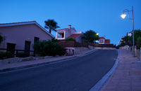 The view of the street of Pissouri village in the evening light. Limassol district. Cyprus