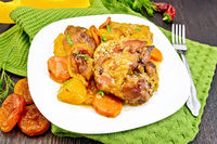 Chicken roast with pumpkin and dried apricots on green napkin