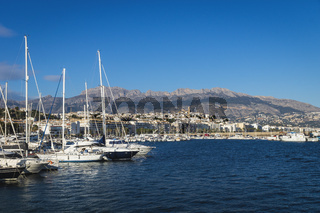 Yachts at the port of Altea with view on mountain range with old city and cathedral, Altea, Costa Blanca, Spain