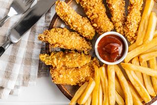 Breaded fried chicken strips.
