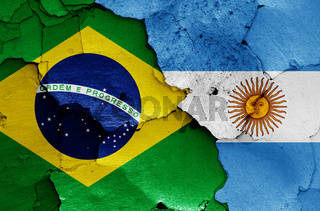 flags of Brazil and Argentina painted on cracked wall