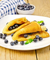 Pancakes with blueberries on board