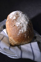 Flour dusted multi grain loaf of bread