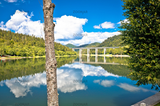 Idyllic Bajer mountain lake and highway A6 viaduct view