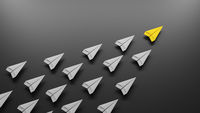 Group of paper planes flying in one direction and one is leading. Business concept for new ideas, innovative solution and creativity.
