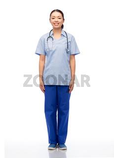 smiling asian female doctor or nurse in uniform