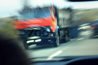truck with red cab on the road in motion. Accident rate
