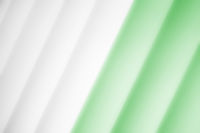 Elegant striped green background pattern fading into white space