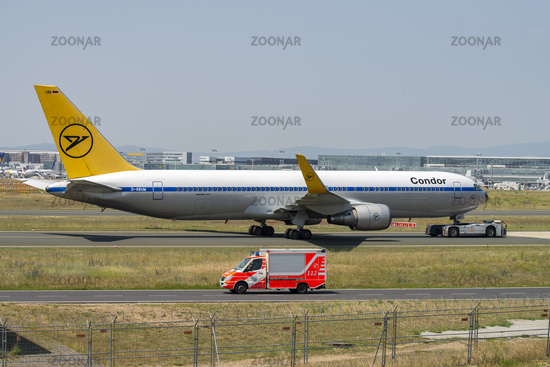 Condor plane is being towed
