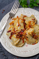 Homemade dumplings with cabbage and onions.