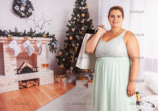 Elegant, curvy woman with shopping bags