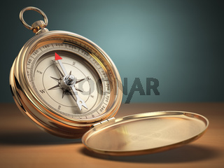 Compass on green background with space for text. Navigation.