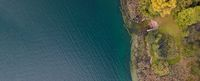 drone shot of people swimming in lake. Copy space