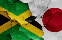 flags of Jamaica and Japan painted on cracked wall