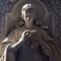 Statue on an old tomb - beginning of 1800, marble - located in Genoa cemetery, Italy
