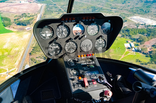 Interior view of dials and instrument panel in small helicopter