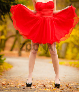 Fashion woman red dress relaxing walking in park