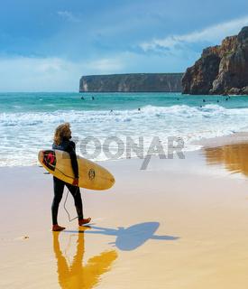Surfing man surfboard Algarve Portugal