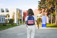 Girl with backpack walking to school