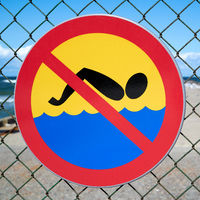 Prohibition sign at the dilapidated pier near Niechorze on the Polish Baltic coast