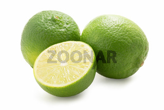 Limes - one sliced - isolated against white