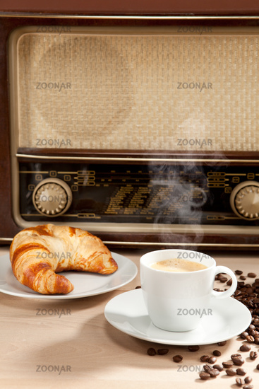 Listening to the radio at breakfast with coffee and croissant