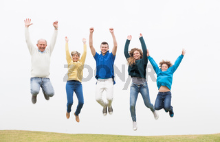 Family jumping on the air at park