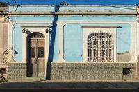 Mexican colonial house facade shined by sun, Merida, Yucatan, Mexico