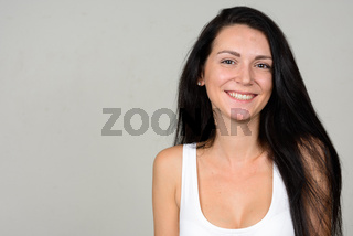 Portrait of happy beautiful woman against white background