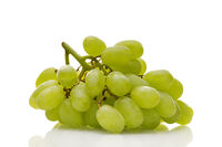 Ripe white wine grapes with stalk isolated on white background. Healthy food, grocery, vegan lifesty