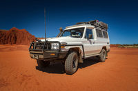 Western Australia – Outback track with 4WD car on red sand at the ocean at Dampier Peninsula