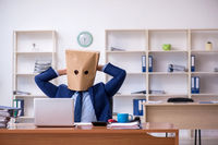 Young male employee with box instead of his head