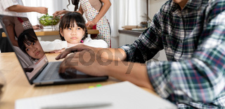 Daughter wait for her dad working.