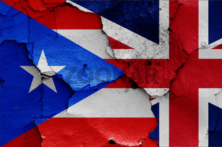 flags of Puerto Rico and UK painted on cracked wall