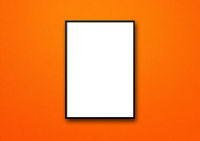 Black picture frame hanging on an orange wall