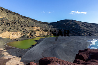 Lagoon with green water (Lago Verde) nearby El Golfo on canary island Lanzarote