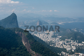 Aerial view of Corcovado, Sugarloaf Mountain and the city of Rio de Janeiro from the Tijuca Forest.