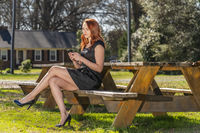 A Lovely Redhead Model Enjoys An Spring Day Outdoors