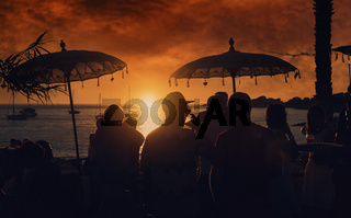 People during the sunset on the Calo des Moro in Ibiza. Spain